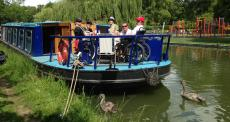 People with disabilities on a blue canal boat