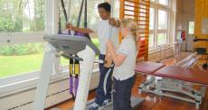 person on treadmill receiving assistance