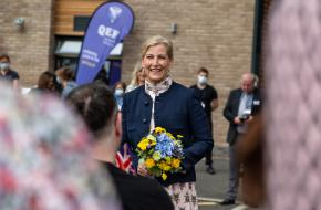 HRH The Countess of Wessex smiling and holding flowers